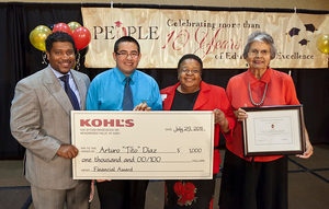 People holding up a check from Kohls
