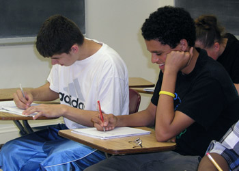 Two students working on desks